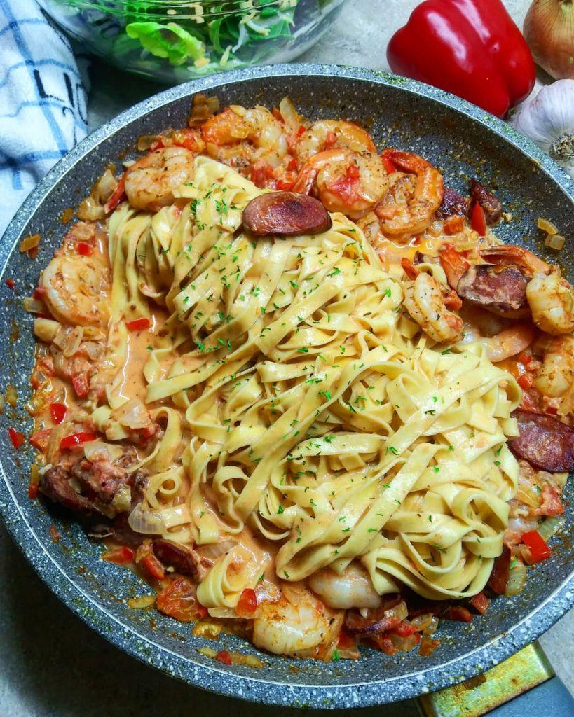 pan of cajun shrimp and sausage pasta with pasta in pan