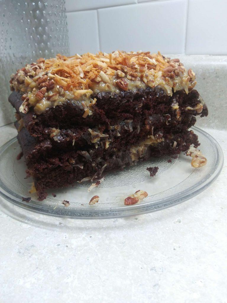 sliced square three layered german chocolate cake