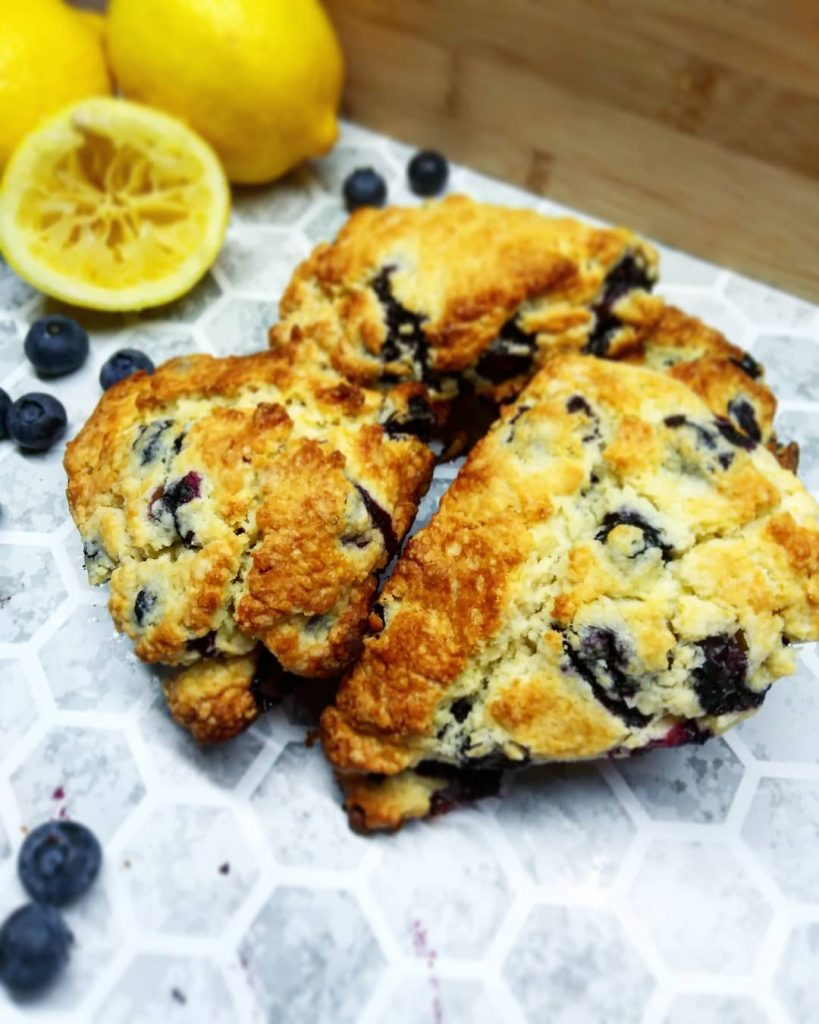 lemon blueberry scones with fresh blueberry and half of squeezed lemon