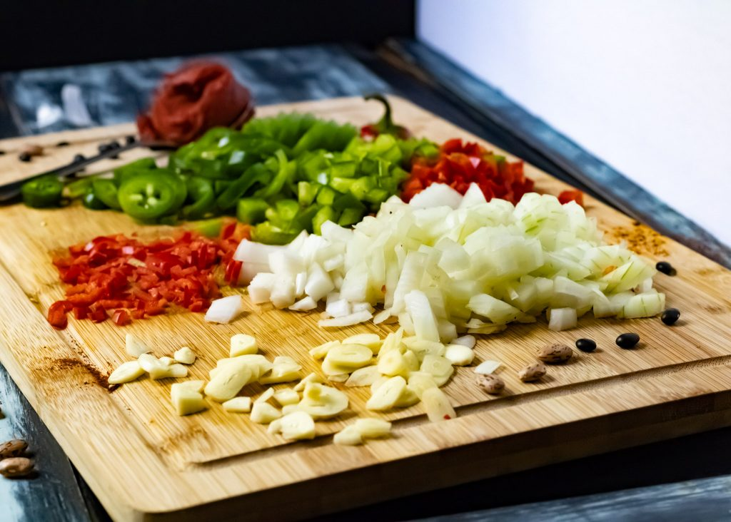 diced vegetables on cutting board for spicy chili